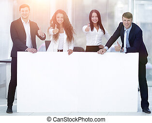 business team holding blank white banner