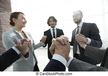 business team holding each other's hands
