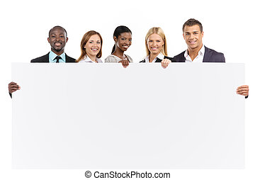 Business team holding white board - Group of people looking...