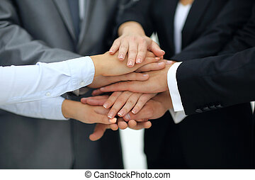 Business team in a meeting with their hands together -...