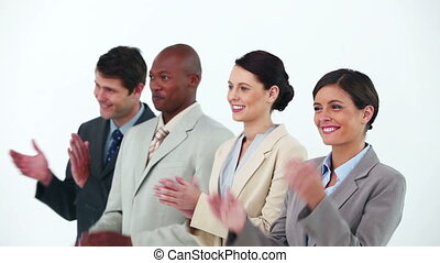 Business team in line applauding