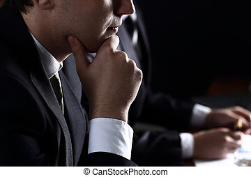 business team in meeting on dark background