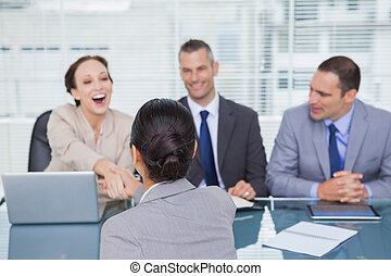 Business team interviewing young applicant
