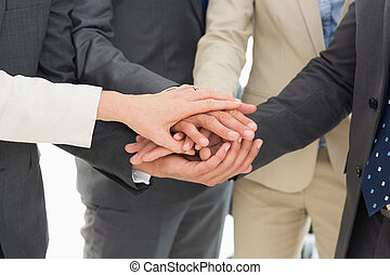 Business team joining hands together - Extreme close-up of a...