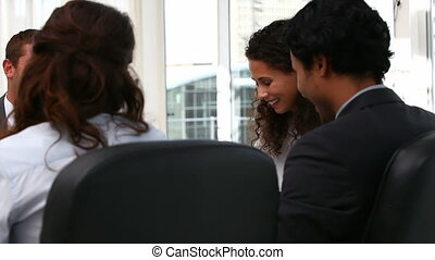 Business team laughing at a meeting