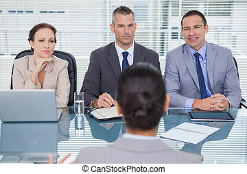 Business team listening to the applicant in interview