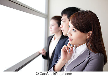 Business team look through window with think face, empty...