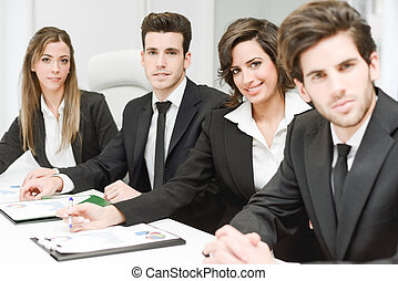 Business team looking at camera in working environment