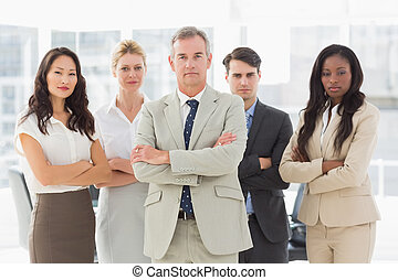 Business team looking at camera with arms crossed