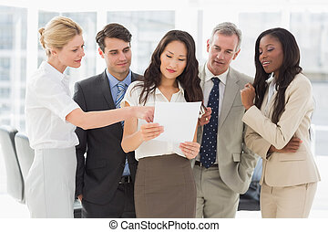 Business team looking at document t