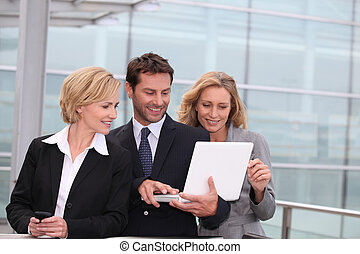 Business team looking at laptop