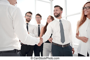 business team looking for a handshake of business partner