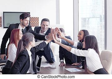 Business team making high five
