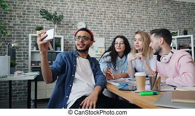 Business team making video call with smartphone calling from...