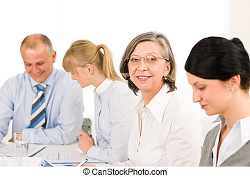 Business team meeting executive senior woman