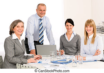 Business team meeting people around table - Business team...