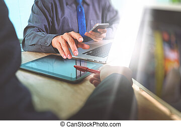 Business team meeting present. Photo professional investor working with new startup project. Finance managers meeting.Digital tablet laptop computer design smart phone using.Sun flare effect