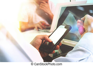 Business team meeting present. Photo professional investor working with new startup project. Finance managers meeting.Digital tablet laptop computer design smart phone using. Blurred background, Sun flare effect,Horizontal