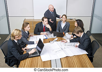 Business team meeting - A business team going over the...