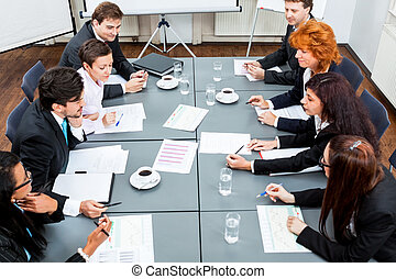 business team on table in office conference