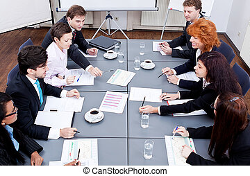 business team on table in office conference seminar...