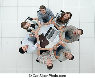 Business team people join hands forming circle
