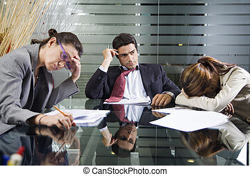 business team - Office life: business team during a meeting...