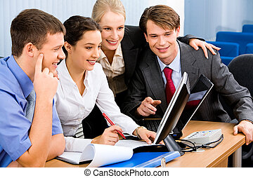 Business team - Portrait of business people looking at a...