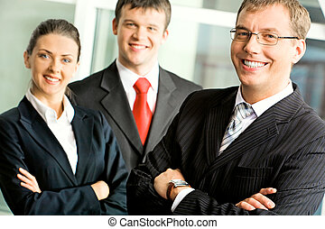 Business team - Portrait of successful businessman in...