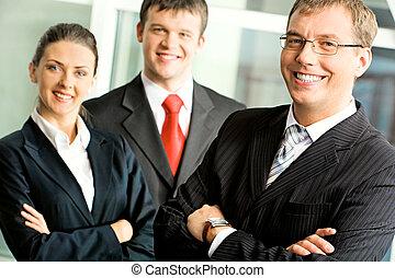 Business team - Portrait of successful businessman in...