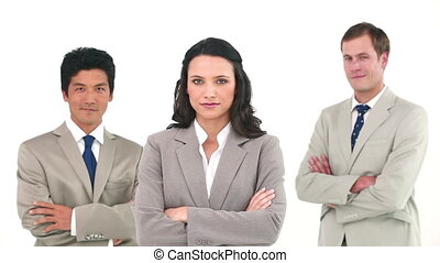 Business team posing their arms crossed against a white...
