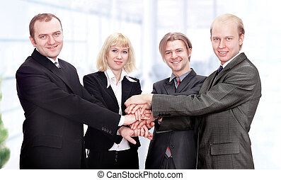 business team put their hands together.