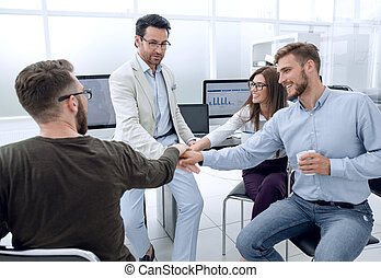 business team putting their hands together in the workplace