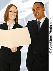 Business Team Reviewing Folder And Smile