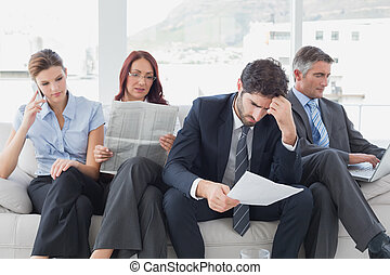 Business team reviewing work notes