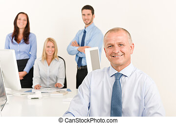 Business team senior manager with work colleagues