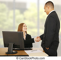Business Team Shake Hand In Modern Office