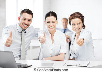 business team showing thumbs up in office - business concept...