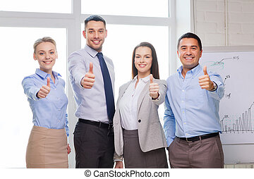 business team showing thumbs up in office - success,...
