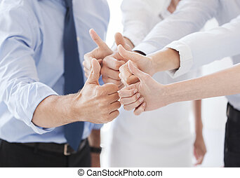 business team showing thumbs up in office - success and...