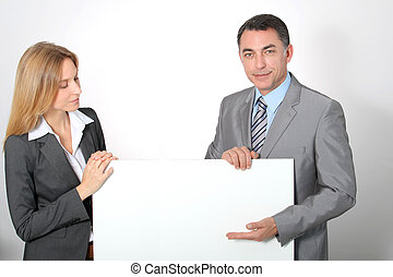 Business team showing white message board