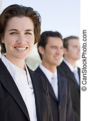Business Team - small group of business people in business...