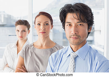 Business team standing all together at work