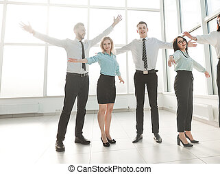 business team standing in spacious new office.