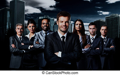 business team standing over a dark background.