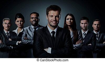 business team standing over a dark background