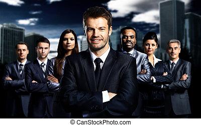business team standing over a dark