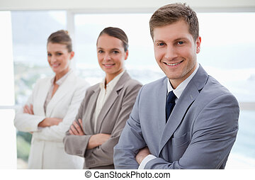 Business team standing with arms folded