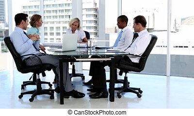 Business team talking around a desk