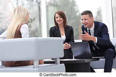 business team talking in office lobby - successful business...